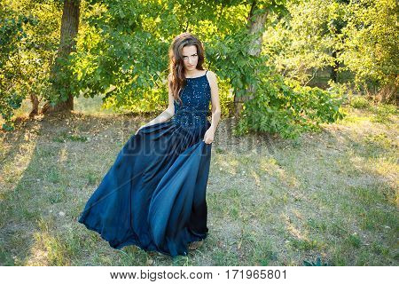 Brunette Dancing In A Long Blue Dress