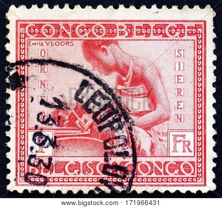 BELGIAN CONGO - CIRCA 1927: a stamp printed in Belgian Congo shows Making pottery craft circa 1927