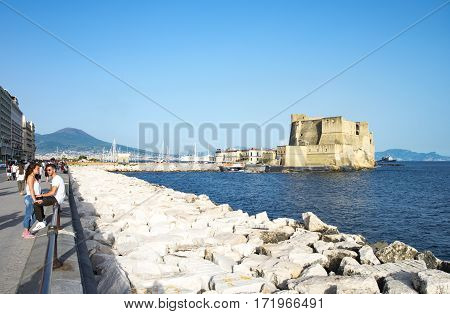 Naples Italy - June 17 2016: View of the Dell'Ovo castle from the waterfront promenade
