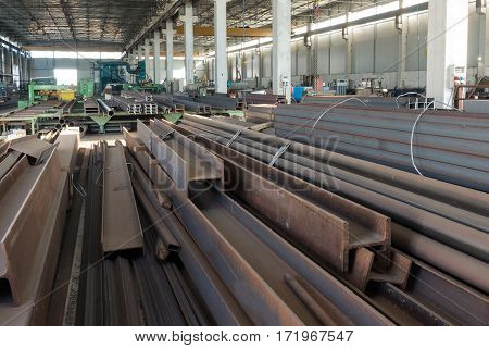 the numerous iron bars inside a factory