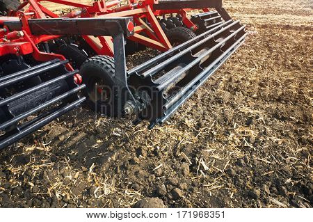 Agricultural machinery in the field. Stubble cultivator close-up.
