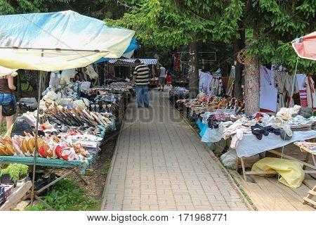 Schodnica Ukraine - June 30 2014: People walking between trade stalls with ukrainian souvenirs