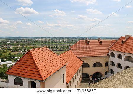 Mukachevo Ukraine - July 2 2014: Interior courtyard of Palanok Castle seen with modern roofs