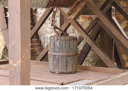Old style wooden well with bucket. Mukachevo Ukraine