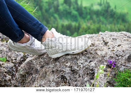 Close Up, Shoes Walking An Lying Hiker Front Of A Mountainous Landscape