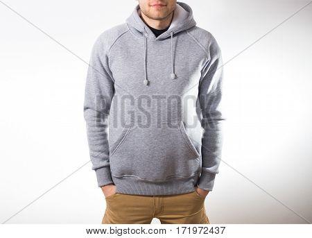 Man, Guy In Blank Grey Hoodie, Sweatshirt, Mock Up Isolated. Plain Hoody Design Presentation.