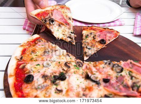 Italian Delicious Hot Pizza On Wooden Plate, On White Table