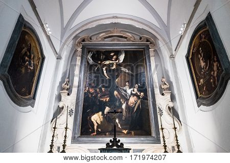 Naples Italy - August 4 2015: A painting by Caravaggio in the Pio Monte Della Misericordia church