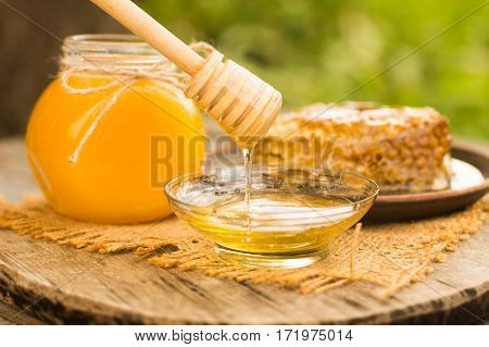 Honey Drip In Jar On The Table