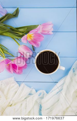 Bouquet Of Tender Pink Tulips With Coffee On Blue Wooden Background
