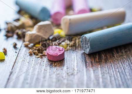 Wreckage of Pastel Chalks. Selective Focus. Wooden Surface
