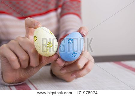 Two Colored Easter Eggs In Female Hands