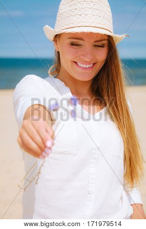 Smiling Girl With Flower On Beach
