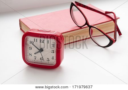 The Red Book, Glasses And Watch On A Light Background