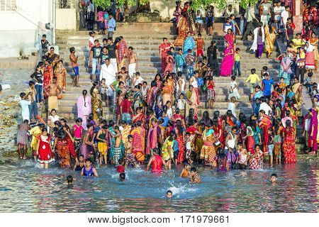 People Cleaning Clothes And Washing In The River Ganges In Calcutta, India.
