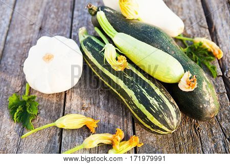 Fresh Organic Zucchini With Flower And Zucchini On The Wooden Table
