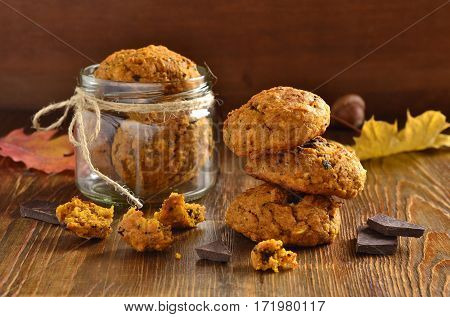Pumpkin cookies with chocolate chips, selective focus