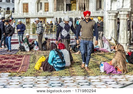 People Pray In The   Harimandir Sahib At The Golden Temple Complex, Amritsar