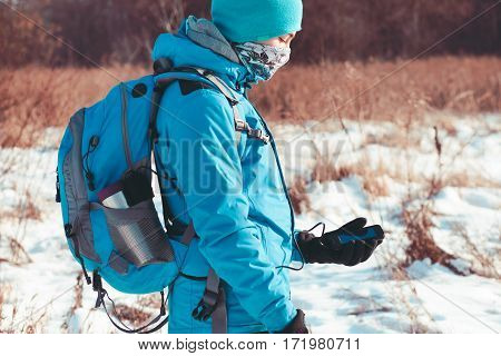Boy Using The Mobile Phone During The Winter Trip