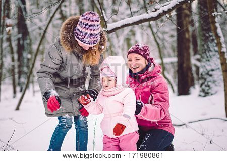 Mother spending time with her children outdoors in the wintertime