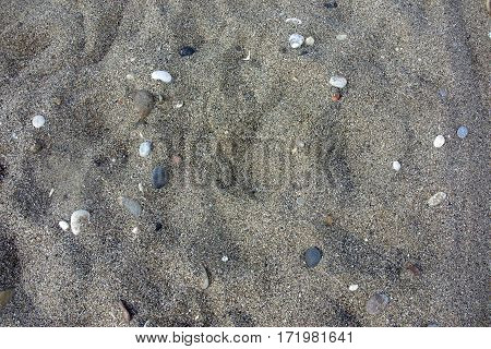 Natural stone and sand wall texture for background.