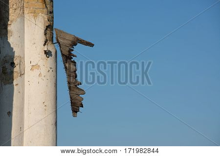 Fragments of old wooden gate on a background of blue sky