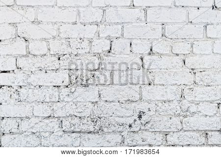 Old white concrete wall with cracks. Textured background