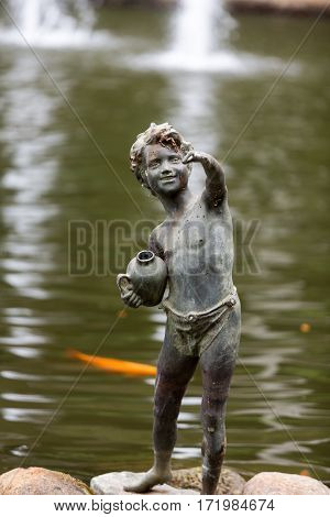 FUNCHAL MADEIRA PORTUGAL - SEPTEMBER 2 2016: Statue of boy in botanical garden Monte of Funchal Madeira. Portugal.
