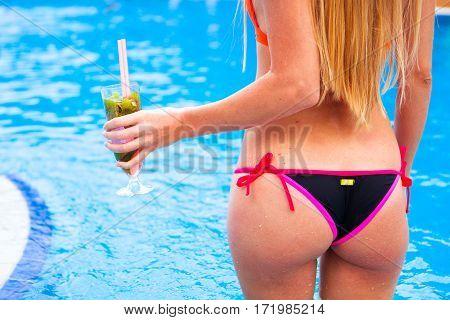Woman In Bikini Hand With Cocktail Glass Strawberry Mojito Near Swimming Poo,  Rear Viewl. Close Up