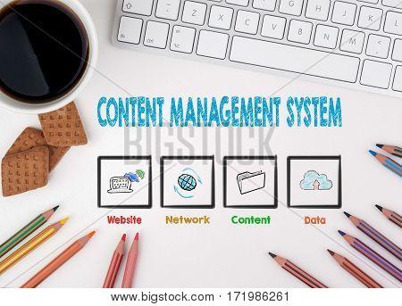 Content Management System Concept. White office desk.