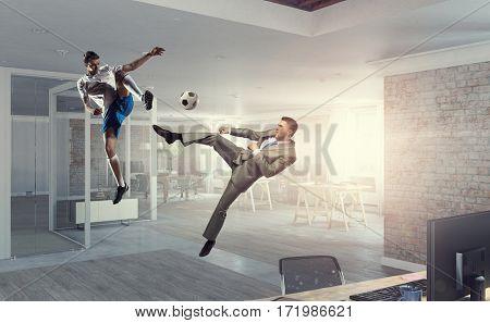 Playing football in office . Mixed media