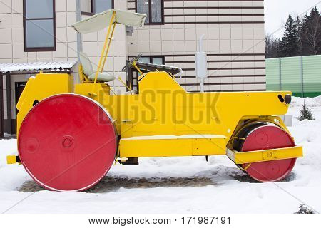 Yellow Retro Road Roller At The Winter Landscape.