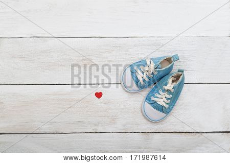 Blue shoes for a little boy on a wooden background. flat lay