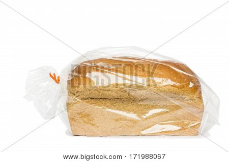 An unsliced loaf of bread in wrapper.