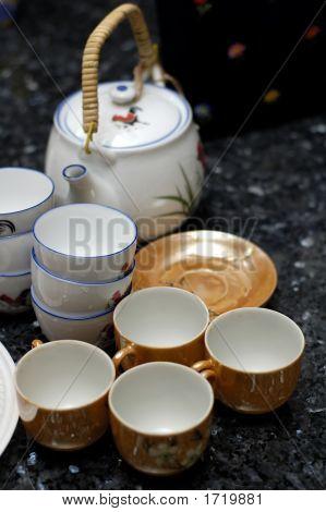 Close Up Of Tea Pot And Cups