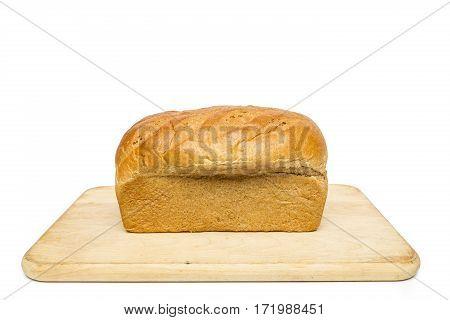 A loaf of honey wheat bread on a cutting board.