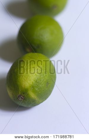 Beauty  yellow and green limes on neutral background