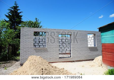 Building New House from Autoclaved Aerated Concrete Blocks. House Construction Site.