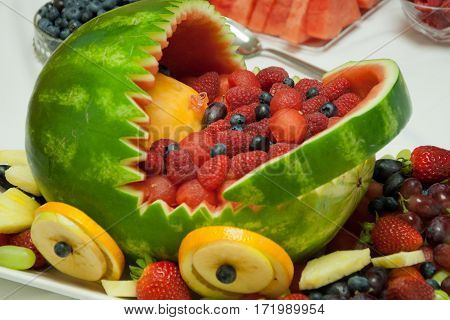 fruits basket from watermelon with different barries