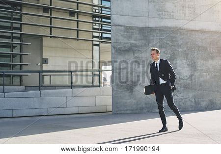 Male In Dark Suit Rushing Down Street