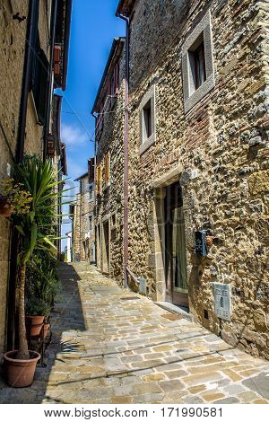 Typical alley in the medieval town of Cortona in tuscany Italy