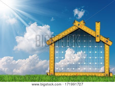 Wooden ruler in the shape of ecologic house on a green grass blue sky with clouds and sun rays. Concept of ecological house project