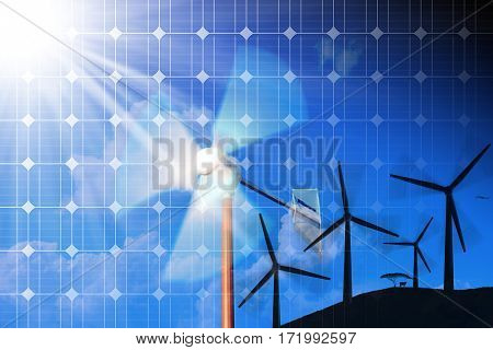 Wind and Solar Energy Concept - Solar panel and a 3D illustration of a group of wind turbines on a blue sky with clouds and sunbeams