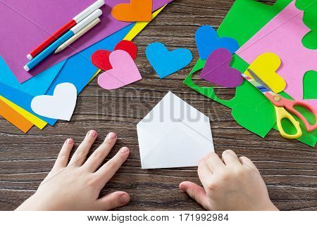 Child Paper Fold Details. Greeting Card With Paper Rainbow Heart. Sheets Of Paper, Glue And Scissors