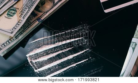 Cocaine Snorted Through Rolled 100 Dollar Banknote.  lifestyle of a drug addict poster