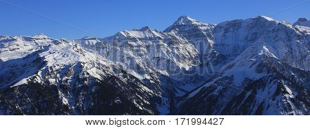 Winter landscape in Glarus Canton. Majestic mountain Hausstock. View from Braunwald.