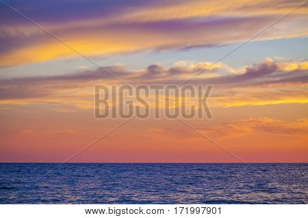 Beautiful colorful clouds at sunset over Adriatic sea