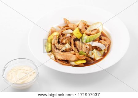 Tori teriyaki, chicken, leeks, oyster, teriyaki sauce in a white plate on a white background