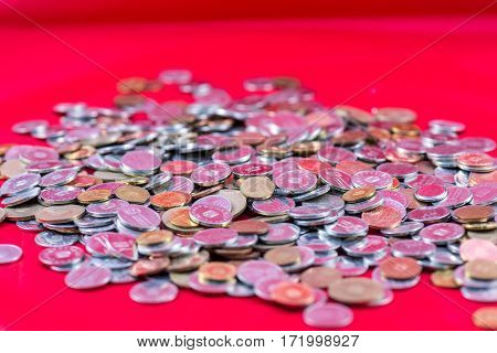A lot of romanian coins on a red background