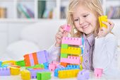 happy cute little girl playing lego game poster